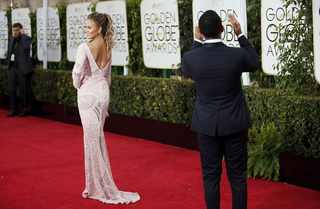 Musician John Legend and his wife, model Chrissy Teigen, arrive at the 72nd Golden Globe Awards in Beverly Hills, California January 11, 2015. (Photo by Danny Moloshok/Reuters)