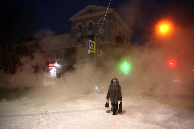 A woman walks in a street in freezing weather of –24 degrees Celsius in Omsk, Russia on January 13, 2021. Daytime temperatures have been below –20 degrees Celsius in the Omsk Region since 25 December 2020. (Photo by Yevgeny Sofiychuk/TASS)
