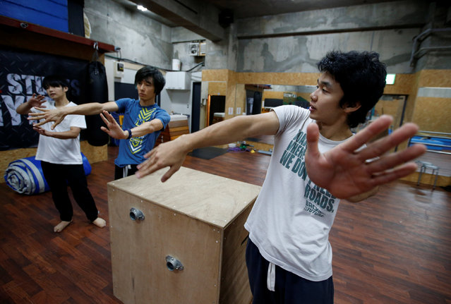Jun Sato (R), founder of Japan's first parkour educational institute SENDAI X-TRAIN, instructs his students at a workshop teaching parkour skill at a gym in Tokyo, Japan October 23, 2016. (Photo by Kim Kyung-Hoon/Reuters)