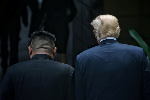 U.S. President Donald Trump walks with North Korean leader Kim Jong Un at the Capella Hotel on Sentosa island in Singapore June 12, 2018. (Photo by Kevin Lim/The Straits Times via Reuters)