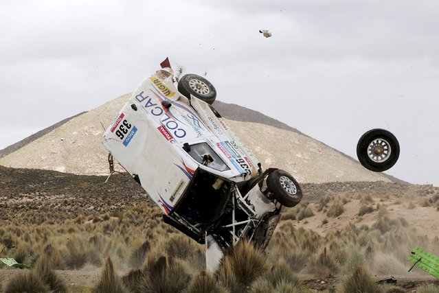Juan Manuel Silva and Pablo Sisterna (not pictured) of Argentina crash in their Mercedes car during the 7th stage of the Dakar Rally from Iquique to Uyuni, January 10, 2015. (Photo by Daniel Rodrigo/Reuters)
