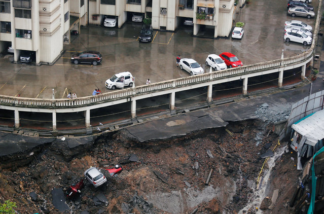 Cars are seen amidst debris after the wall of a residential building collapsed due to heavy rains in Mumbai, June 25, 2018. India' s monsoon season runs from June to September. (Photo by Francis Mascarenhas/Reuters)