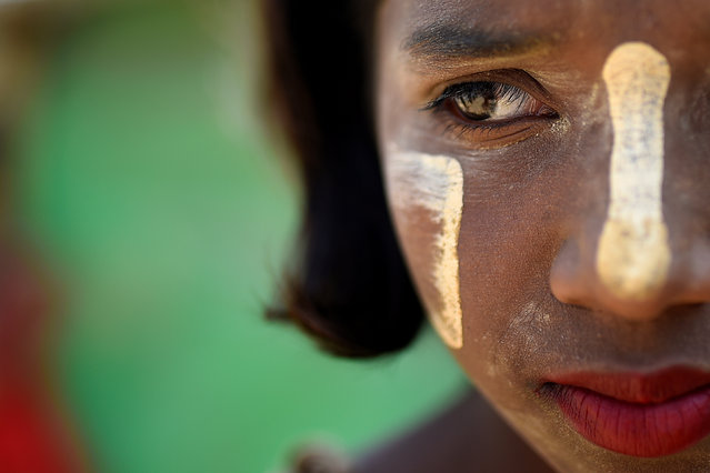 Shamima, 10. Thanaka is used to a lesser extent by men and boys. (Photo by Clodagh Kilcoyne/Reuters)