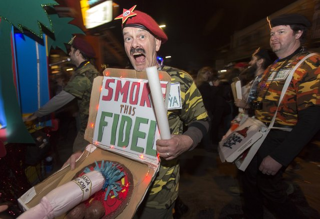 In a pun at Cuban leader Fidel Castro, a man displays a displays a fake cigar in the Krewe du Vieux 2015 parade, the first parade of the Mardi Gras festivities, through the French Quarter in New Orleans January 31, 2015. (Photo by Lee Celano/Reuters)