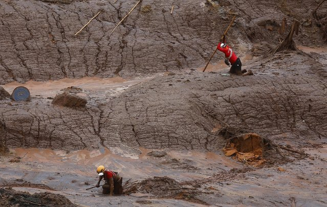 Rescue workers search for victims at the Bento Rodrigues district that was covered with mud after a dam, owned by Vale SA and BHP Billiton Ltd, burst in Mariana, Brazil, November 8, 2015. (Photo by Ricardo Moraes/Reuters)