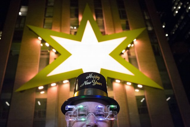 George Miller, 51, of Orlando, Florida poses for a photo in his decorative hat and glasses at the New Years Eve event Chi-Town Rising in Chicago, Illinois, United States, December 31, 2015. (Photo by Alex Wroblewski/Reuters)