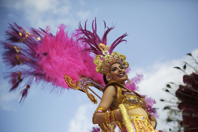 A reveler is seen during the third day of the annual Carnival parade in Panama City February 16, 2015. (Photo by Carlos Jasso/Reuters)