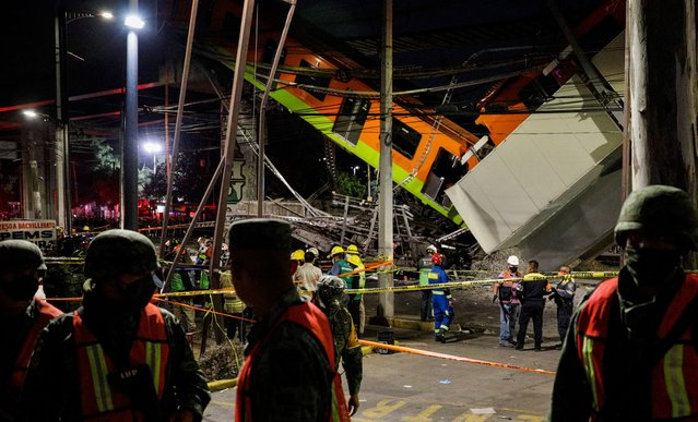 Rescuers work at a site where an overpass for a metro partially collapsed with train cars on it at Olivos station in Mexico City, Mexico, early May 4, 2021. (Photo by Luis Cortes/Reuters)