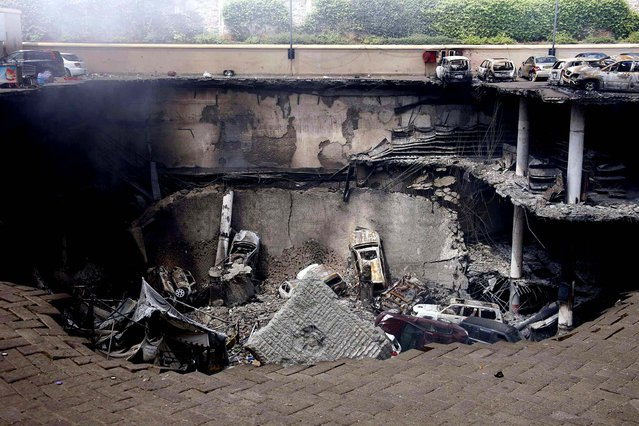 Destruction is seen at the Westgate Mall in Nairobi, on September 26, 2013, following a string of explosions during a stand-off between Kenyan security forces and gunmen inside the building. In Nairobi, experts from the U.S., British, Israei and other agencies have joined Kenyan officers investigating the mall where militants from the al Qaeda-aligned Somali group al Shabaab launched a well-planned assault on Saturday. (Photo by Presidential Strategic Communications Unit)