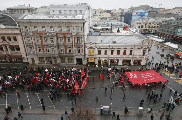 Supporters and activists of the Russian Communist party take part in a procession to mark the Defender of the Fatherland Day in central Moscow February 23, 2015. (Photo by Maxim Zmeyev/Reuters)