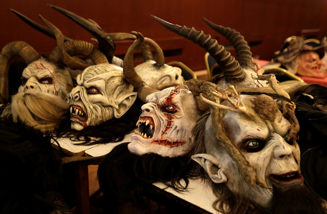 Masks of the devil lies on a table before a Krampus show, the traditional parade where people in costumes and masks perform an old ritual to disperse the ghosts of winter, in the southern Bohemian town of Kaplice, December 10, 2016. (Photo by David W. Cerny/Reuters)