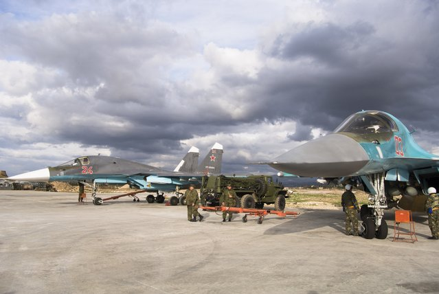 A pair of Russian bombers being readied for action at Hemeimeem air base in Syria on Wednesday January 20, 2016. (Photo by Vladimir Isachenkov/AP Photo)