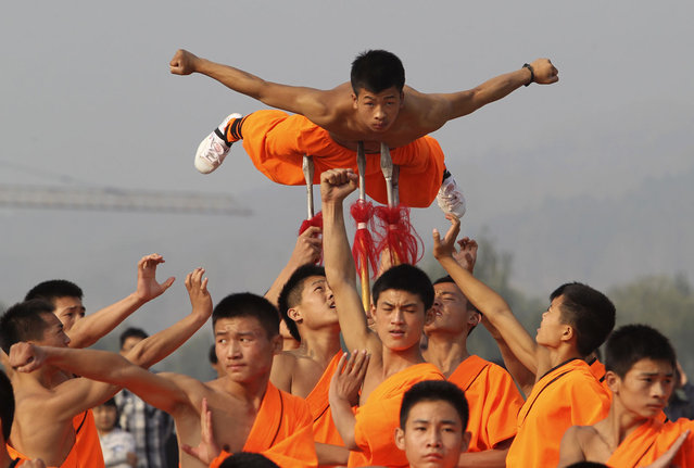 Shaolin martial arts students perform at Shaolin Temple in Dengfeng, Henan province, October 13, 2013. (Photo by Reuters/Stringer)