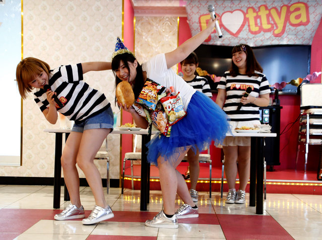 Michiko Ohashi (C), wearing a costume decorated with snacks, performs with other members of pop group Pottya at a fan meeting celebrating her birthday in Tokyo, Japan, October 16, 2016. (Photo by Kim Kyung-Hoon/Reuters)