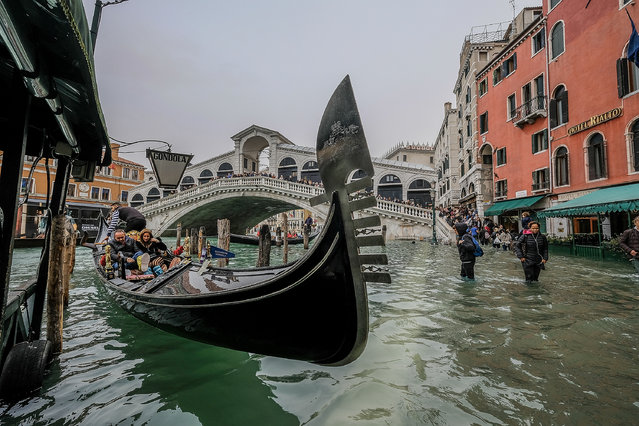 "Tourists take the gondola in spite of the ""acqua alta"" on October 29, 2018 in Venice, Italy. (Photo by Stefano Mazzola/Awakening/Getty Images)"