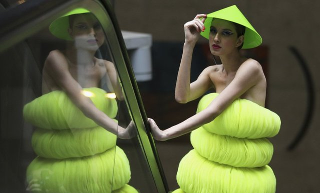 A model presents a creation in a subway station during the Sao Paulo Fashion Week in Sao Paulo October 27, 2013. (Photo by Paulo Whitaker/Reuters)