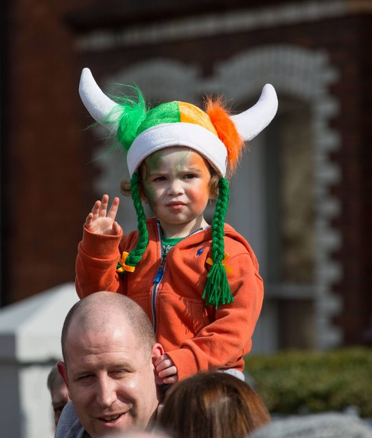 Enjoying the parade was Fionn McKinley, 3, Corbally Limerick on March 17, 2015. Limerick St. Patrick's Festival featured the giant st. Patricks day parade. Over 80, 000 people lined the streets to watch the Spring Themed parade makes its way along O'Connell St. (Photo by Alan Place/FusionShooters)
