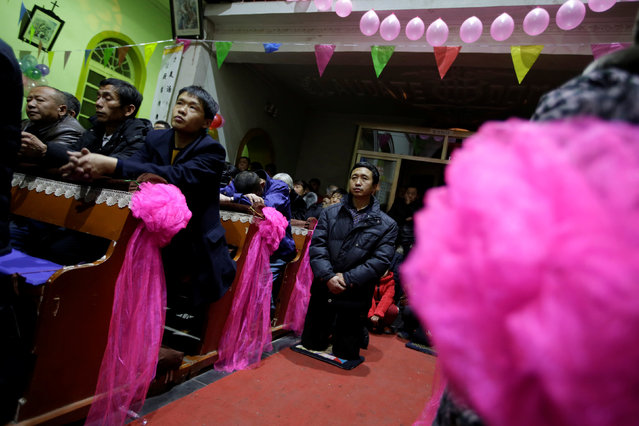 Villagers attend a Christmas eve mass at a Catholic church after midnight on the outskirts of Taiyuan, North China's Shanxi province, December 24, 2016. (Photo by Jason Lee/Reuters)