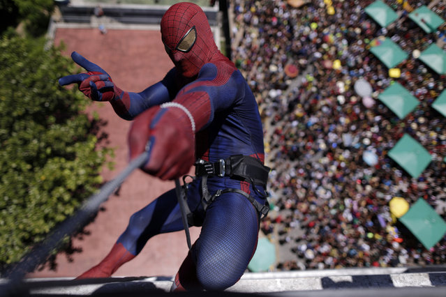 "A reveller dressed as Spider-Man takes part in a presentation at the top of a building during an annual block party known as ""Enquanto isso na Sala da Justiça"" (Meanwhile, in the justice room), one of the many carnival parties taking place in the neighbourhood of Olinda, Brazil February 7, 2016. (Photo by Ueslei Marcelino/Reuters)"