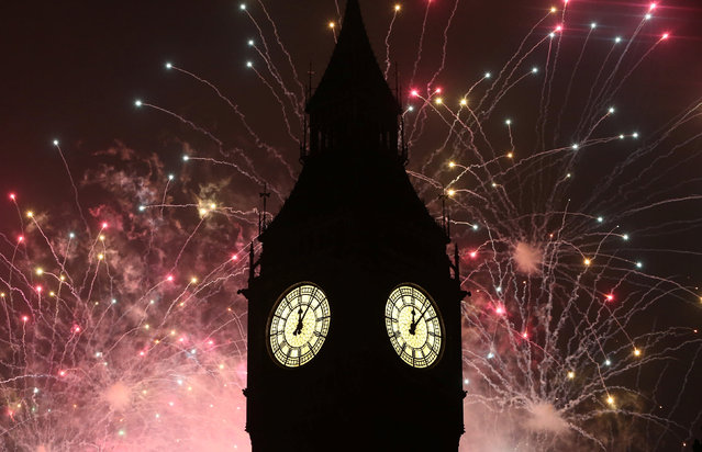 Fireworks explode by the Big Ben clocktower in London, Britain January 1, 2017. (Photo by Neil Hall/Reuters)