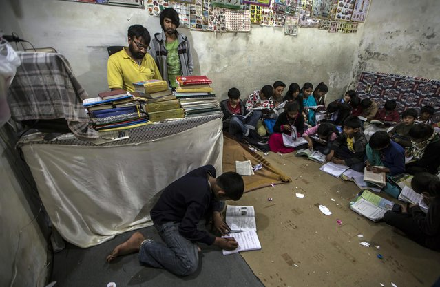 Children study at a tuition centre at a slum in Islamabad March 12, 2015. (Photo by Zohra Bensemra/Reuters)