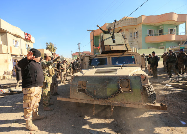 Iraqi army members ride in a military vehicle during a battle with Islamic State militants, in the village of Argoob, Iraq, January 6, 2017. (Photo by Ari Jalal/Reuters)