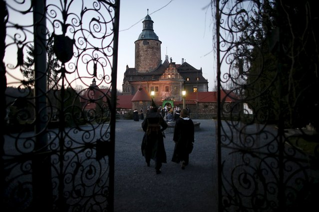 Participants walk as they wait for the beginning of the role play event at Czocha Castle in Sucha, west southern Poland April 9, 2015. (Photo by Kacper Pempel/Reuters)