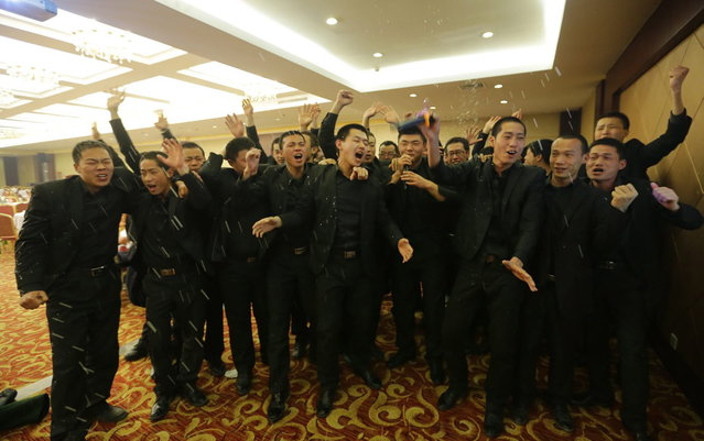 Students at Tianjiao Special Guard/Security Consultant sing during a group dinner on the outskirts of Beijing December 14, 2013. (Photo by Jason Lee/Reuters)
