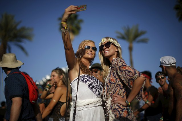 Women pose for a selfie photo at the Coachella Valley Music and Arts Festival in Indio, California April 11, 2015. (Photo by Lucy Nicholson/Reuters)