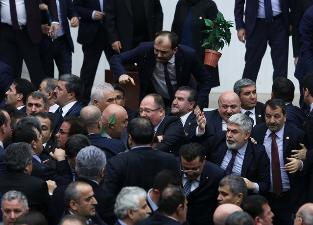 Lawmakers from ruling AK Party and the main opposition Republican People's Party (CHP) scuffle during a debate on the proposed constitutional changes at the Turkish Parliament in Ankara, Turkey, January 12, 2017. (Photo by Reuters/Stringer)