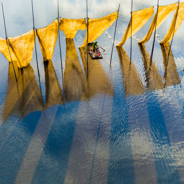 Catching the winning image. Fishermen close the net in Fujian province in China. This was the grand prize winner in the competition. (Photo by Ge Zheng/SkyPixel)