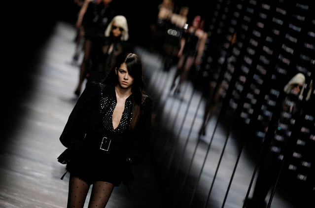 A model presents a creation by designer Anthony Vaccarello as part of his Fall/Winter 2019-2020 women's ready-to-wear collection for fashion house Saint Laurent during Paris Fashion Week in Paris, France, February 26, 2019. (Photo by Regis Duvignau/Reuters)