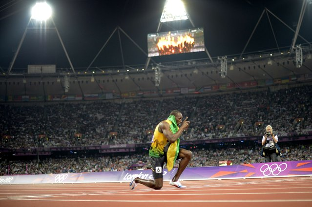 Jamaica's Usain Bolt celebrates after Jamaica won and set a new world record in the men's 4X100 relay final at the athletics event of the London 2012 Olympic Games on August 11, 2012 in London. (Photo by Adrian Dennis/AFP Photo)