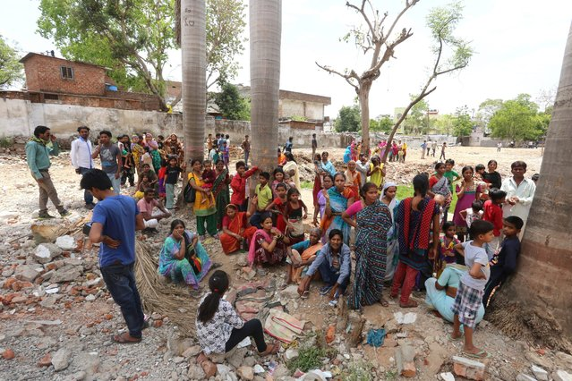 Indian people gather outside in an open space after earthquake tremors were felt in Bhopal, India, 25 April 2015. Strong tremors were also felt in large areas of northern and eastern India, after a 7.9-magnitude earthquake near Pokhara in Nepal shook the whole region. (Photo by Sanjeev Gupta/EPA)