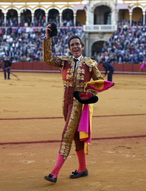 Spanish matador Eduardo Davila Miura celebrates with his trophy, a ear of a bull he killed, during a bullfight at The Maestranza bullring in the Andalusian capital of Seville, southern Spain April 26, 2015. (Photo by Marcelo del Pozo/Reuters)