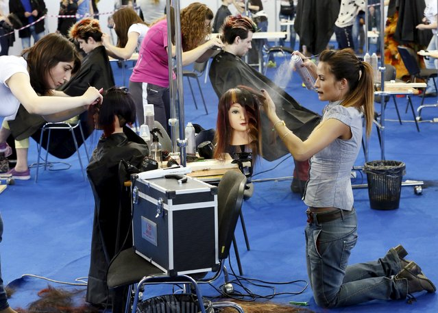 "Hair stylists and designers take part in the ""Ideal of Beauty"" festival and exhibition in Russia's Siberian city of Krasnoyarsk, April 25, 2015. (Photo by Ilya Naymushin/Reuters)"