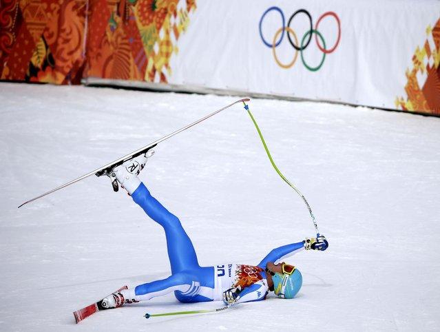 Italy's Christof Innerhofer celebrates after finishing the men's downhill of the Sochi 2014 Winter Olympics, in Krasnaya Polyana, Russia, on February 9, 2014. (Photo by Gero Breloer/Associated Press)