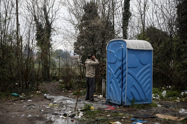 A migrant washes himself at a makeshift camp for refugees and migrants at the Greek-Macedonian border, near the village of Idomeni, Greece March 16, 2016. (Photo by Alkis Konstantinidis/Reuters)