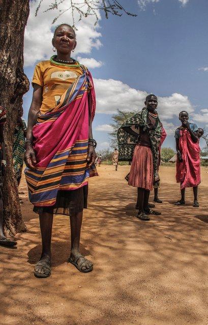 Pokot tribeswomen are usually more decorated than Karamojong women, Karamoja, Uganda, February, 2017. (Photo by Sumy Sadurni/Barcroft Images)