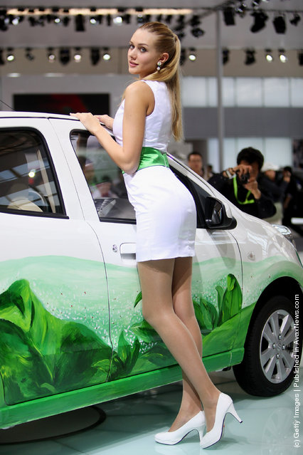 A model stands beside China's Changan car