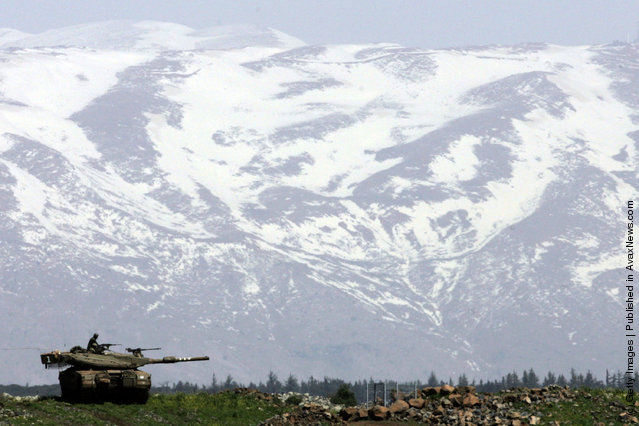 An Israeli army Merkeva tank is seen against the snow-clad Mt. Hermon during a training exercise