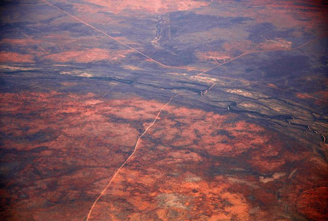 A dirt road and river intersect in the Tanami Desert, located in Australia's Northern Territory, in this July 15, 2013 file photo. (Photo by David Gray/Reuters)