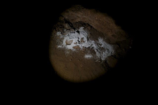 "The ashes of the late Bob, ""The English Quixote"", are seen scattered inside Montesinos cave, where Don Quixote descends in the second part of the novel, by the Ruidera lagoons, Spain, April 8, 2016. (Photo by Susana Vera/Reuters)"
