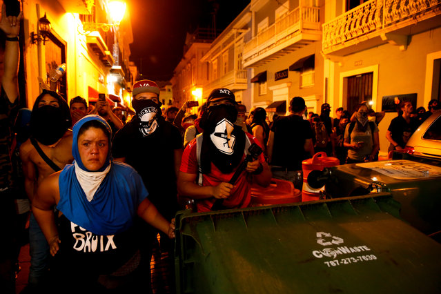 Protestors barricade the street leading to the governor's mansion on July 15, 2019 in Old San Juan, Puerto Rico as they clash with riot police. On the third day of protests, thousands marched calling on Gov. Ricardo Rossello to step down after a group chat was exposed that included misogynistic and homophobic comments. (Photo by Jose Jimenez/Getty Images)