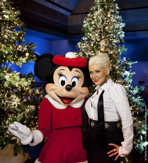 Christina Aguilera poses with Minnie Mouse following the taping  of the 2011 Disney Parks Christmas Day Parade