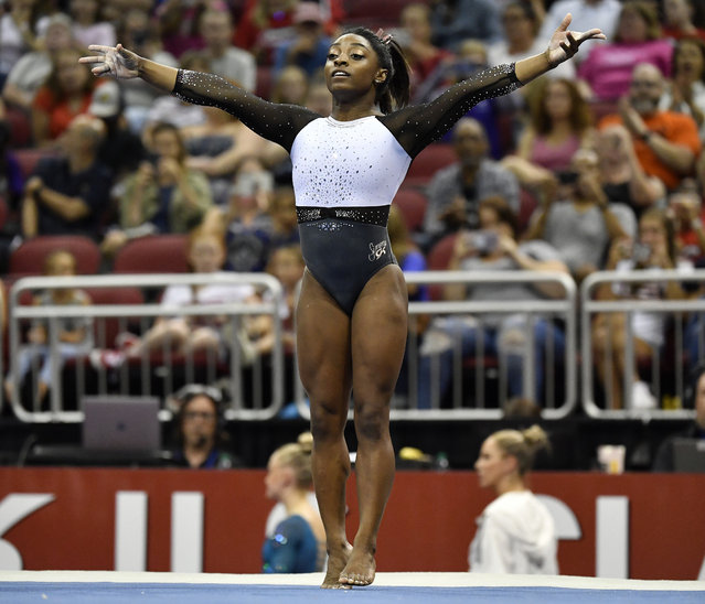 Simone Biles begins her floor exercise routine during the GK US Classic gymnastics meet in Louisville, Ky., Saturday, July 20, 2019. (Photo by Timothy D. Easley/AP Photo)