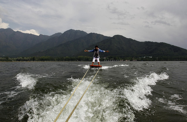 An Indian tourist enjoys water skiing on the waters of Dal Lake in Srinagar June 10, 2012. (Photo by Fayaz Kabli/Reuters)
