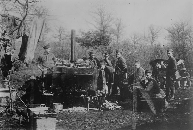 American soldiers of the Machine Gun Battalion, Company G, Second Brigade, gather around an outdoor kitchen in Hermitage, France, March 11, 1918. (Photo by Reuters/Courtesy Library of Congress)