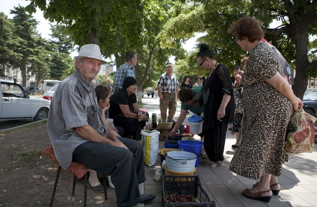 Vendors sell food stuffs in a street in Tskhinvali, the capital of the breakaway region of South Ossetia, Georgia, July 6, 2015. (Photo by Kazbek Basaev/Reuters)