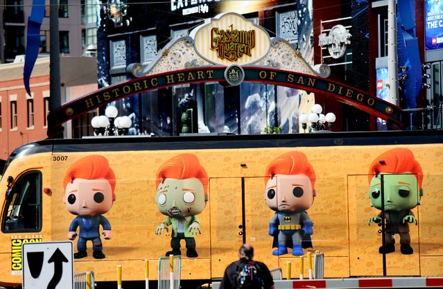 A wrapped advertisement for The Conan O'Brian Show adorns a trolley car as it passes by the Gaslamp Quarter outside of  the 2015 Comic-Con International in San Diego, California July 8, 2015. (Photo by Sandy Huffaker/Reuters)